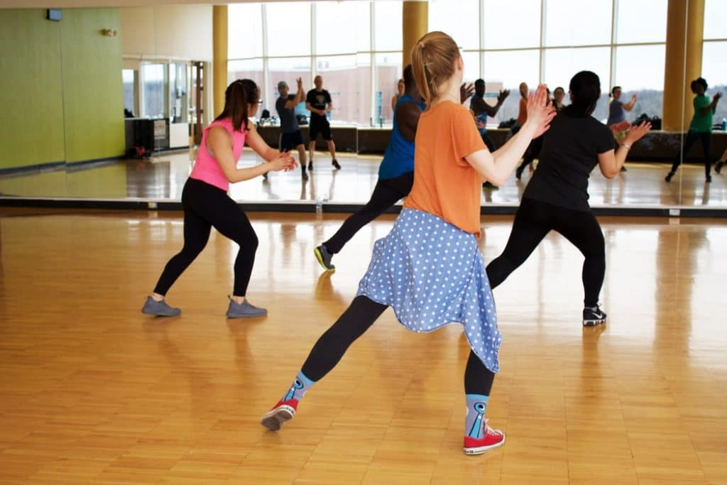 A Jazzercise dance class practices